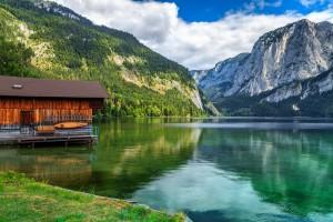 Wooden boat dock with high rocky mountains in background,Altaussee,Salzkammergut,Austria,Europe